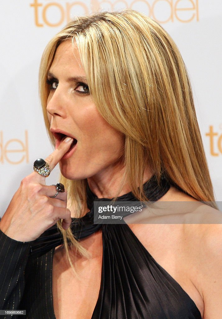 German model Heidi Klum tastes a birthday cake for her upcoming June 1 birthday at a photo call for the reality television show and modeling competition Germany's Next Topmodel at the Waldorf Astoria hotel on May 27, 2013 in Berlin, Germany. The show is currently in its eighth cycle and Klum is the lead judge and executive producer of the show.