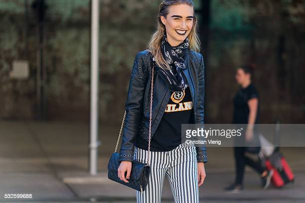 German model Manuela Tatjana wearing a black scarf leather jacket shirt and blue white striped pants at MercedesBenz Fashion Week Resort 17...