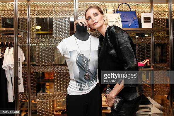 German model Nadja Auermann with her charity shirt during the ESCADA Flagship Store Opening on June 23 2016 in Duesseldorf Germany