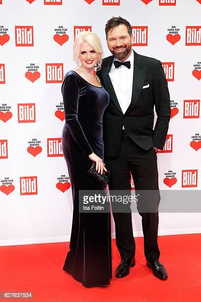 German model Sarah Knappik and german moderator Ingo Nommsen attends the Ein Herz Fuer Kinder gala on December 3 2016 in Berlin Germany