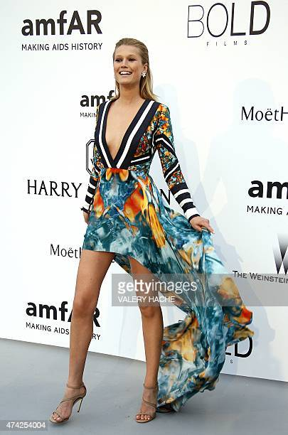 German model Toni Garrn poses as she arrives for the amfAR 22st Annual Cinema Against AIDS during the 68th Cannes Film Festival at Hotel du...