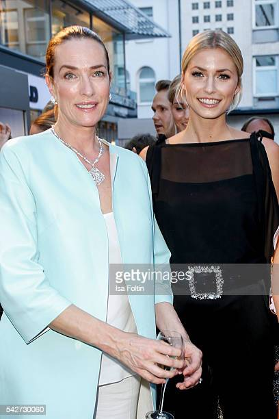 German Models Tatjana Patitz and Lena Gercke attend the ESCADA Flagship Store Opening on June 23 2016 in Duesseldorf Germany