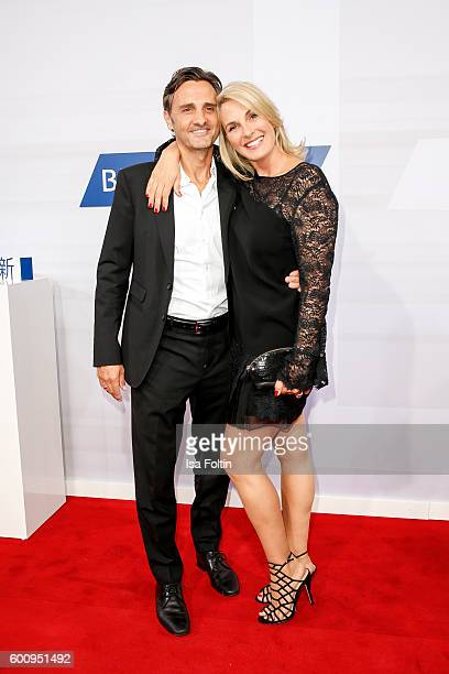 German moderator Britt Hagedorn and her husband attend the Bertelsmann Summer Party at Bertelsmann Repraesentanz on September 8 2016 in Berlin Germany