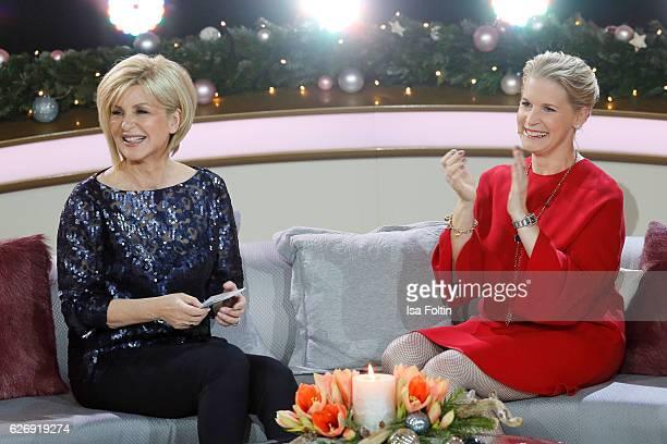 German moderator Carmen Nebel and chef Cornelia Poletto during the tv show 'Die schoensten Weihnachtshits' on November 30 2016 in Munich Germany
