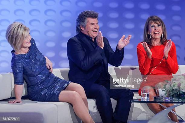 German moderator Carmen Nebel german singer Andy Borg and singer Ireen Sheer during the tv show 'Willkommen bei Carmen Nebel' at Velodrom on October...