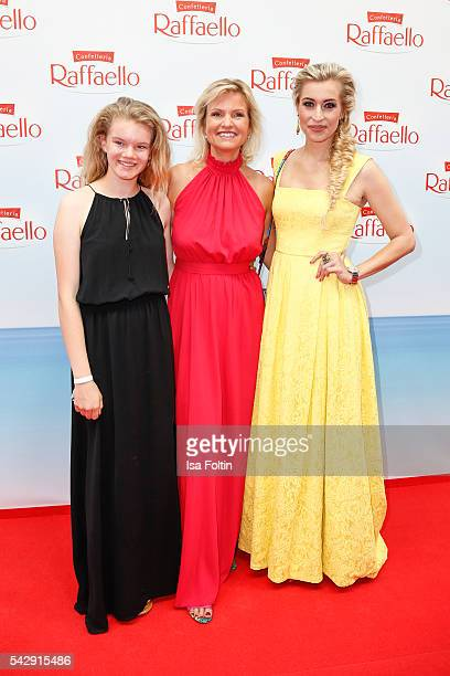 German moderator Carola Ferstl with her daughter Julia Ferstl and german moderator Verena Kerth in the colors of german ensign attend the Raffaello...