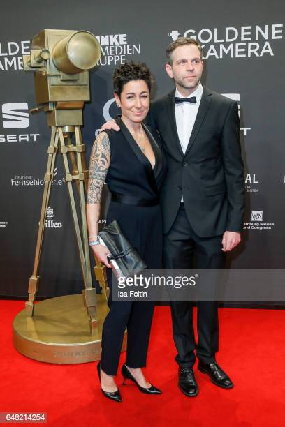 German moderator Dunja Hayali and Jan Boehmermann arrive for the Goldene Kamera on March 4 2017 in Hamburg Germany
