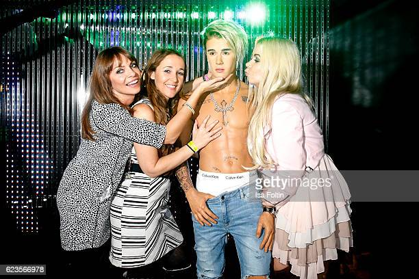 German moderator Jean Bork german moderator Claudia Campus and Lifestyle Blogger Nadine Trompka with Justin Bieber was figure during the unveiling of...