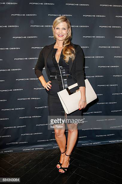 German moderator Verena Wriedt holding a handbag by Porsche Design during presentation of the Porsche Design Timepieces '1919 Datetimer Eternity...