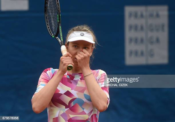 German Mona Barthel reacts after winning over Czech's Kristyna Pliskova during their final tennis match at the Prague Open on May 6 2017 in Prague /...