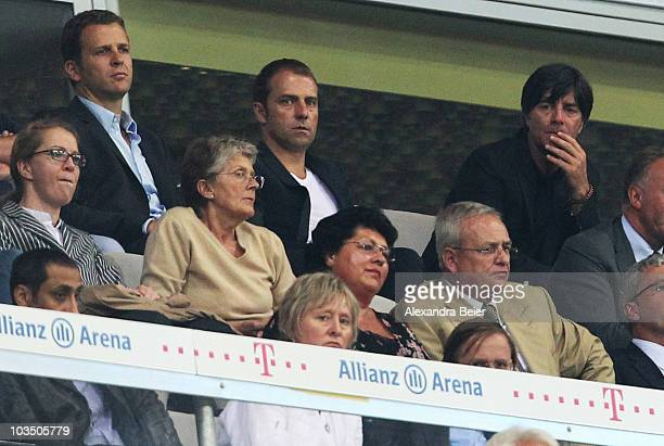 German national coach Joachim Loew national assistent coach Hansi Flick and manager Oliver Bierhoff watch the Bundesliga match between FC Bayern...