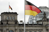 German national flag flies at halfmast on the top of the Reichstag building and in front of the chancellery on March 12 2009 in Berlin Germany 17...