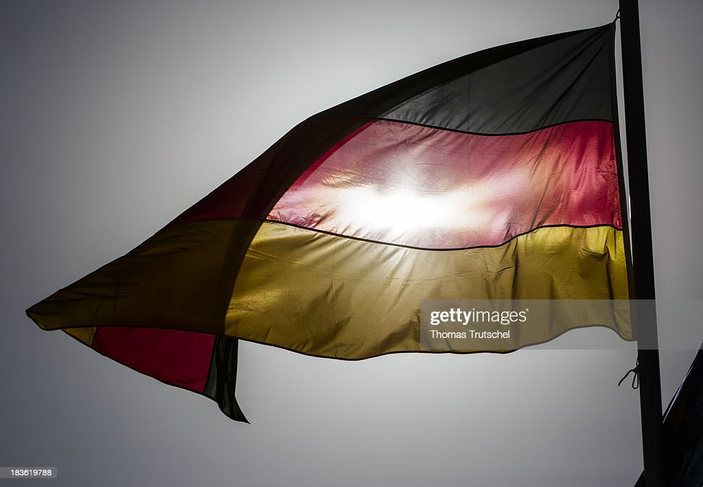 A German national flag flies at PRT Kunduz on October 06, 2013 in Kunduz, Afghanistan. Westerwelle and de Maiziere visit Afghanistan to hand over German PRT in Kunduz to the Afghan Military.