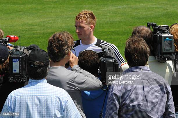 German national football team midfielder Marco Reus speaks to the press during a training session at Andrea Corda Stadium on May 14 2012 in Abbidiori...