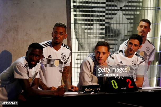 German national football team's defender Jerome Boateng defender Antonio Ruediger and midfielder Lars Stindl play the referees during an animation as...