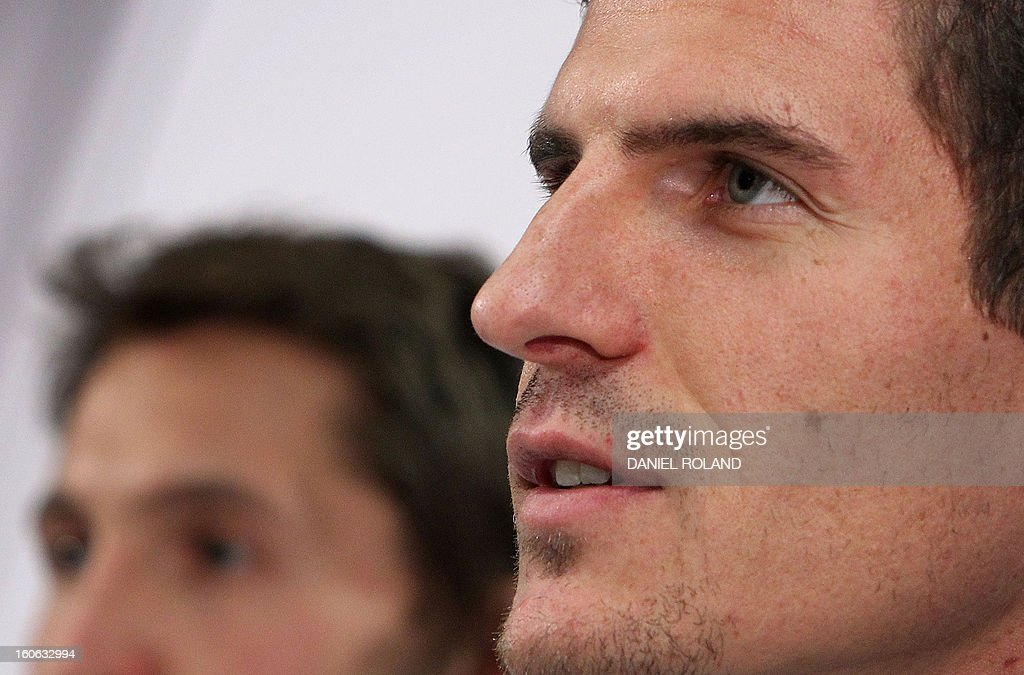 German national football team's forward Mario Gomez (R) and goalkeeper Rene Adler attend a press conference in Frankfurt am Main, on February 04, 2013 ahead of the international friendly game against France to be held in Paris on February 6. ROLAND