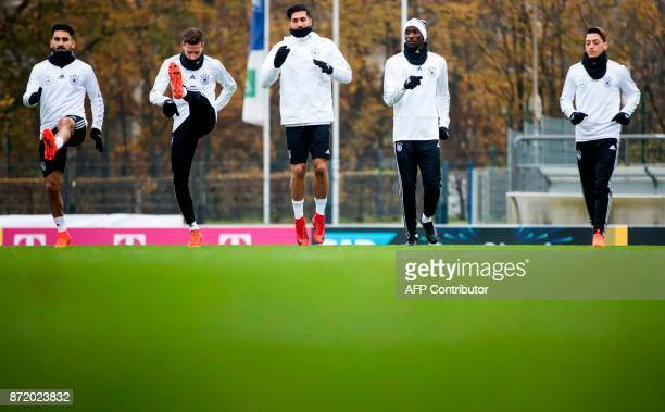German national football team's midfielder Ilkay Guendogan midfielder Julian Draxler defender Emre Can defender Antonio Ruediger and midfielder Mesut...