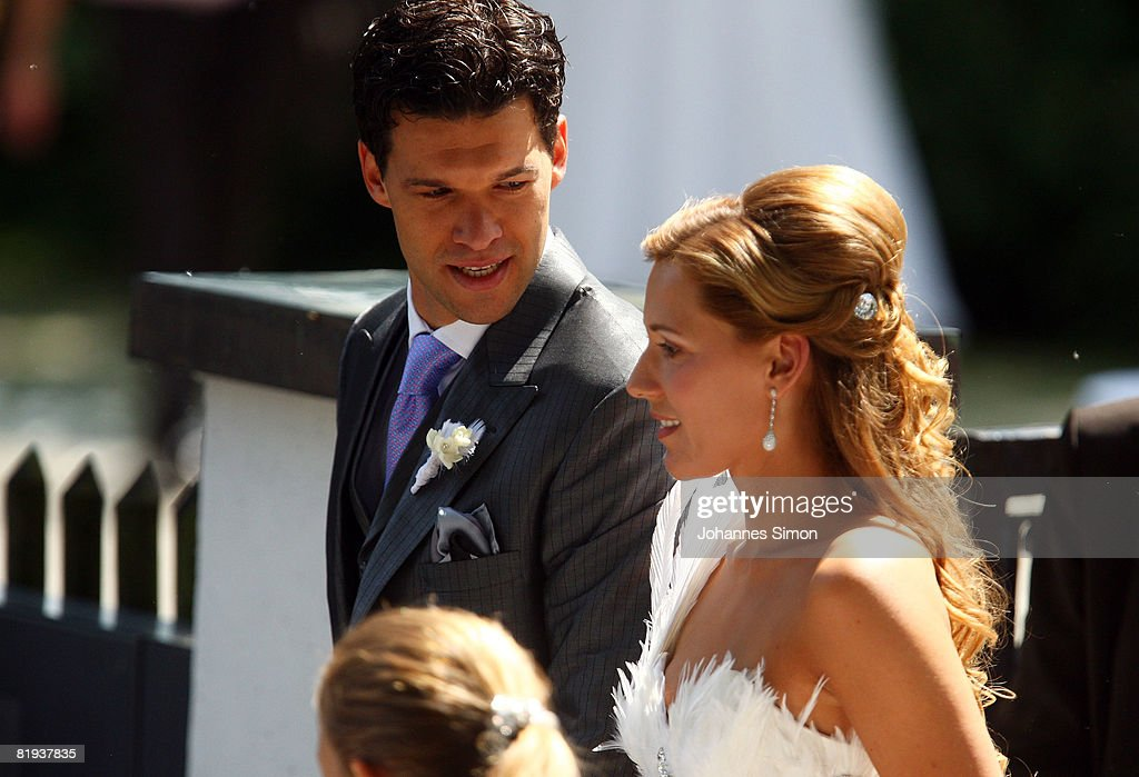 German national player Michael Ballack (L) and Simone Lambe are seen after the ecclestical wedding ceremony at Bayerischer Yacht Club on July 15, 2008 in Starnberg, Germany.