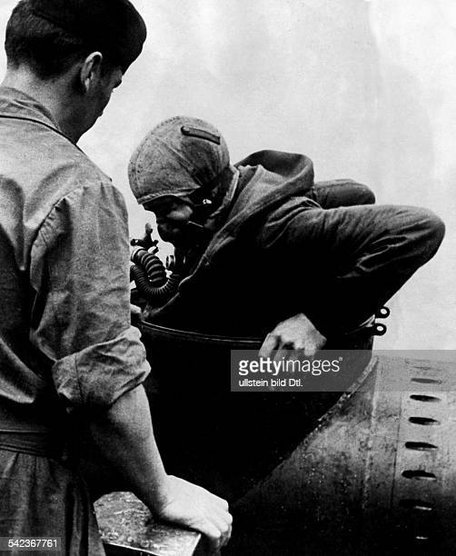 2WW German Navy Frogmen enters into a onemantorpedo to start a combat mission no further inf Nov 1944
