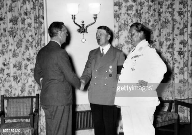 German Nazi Foreign Minister Joachim Von Ribbentrop is congratulated upon his arrival in Berlin by German nazi chancellor Adolf Hitler and German...