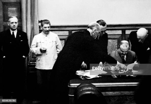 German Nazi Foreign Minister Joachim Von Ribbentrop Soviet head of state Joseph Stalin and his Foreign Minister Vyacheslav Molotov are seen on 23...