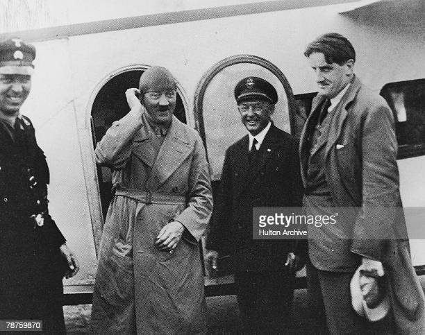 German Nazi leader Adolf Hitler a with his personal pilot Hans Baur and confidante Ernst Hanfstaengl during an election campaign circa 1930