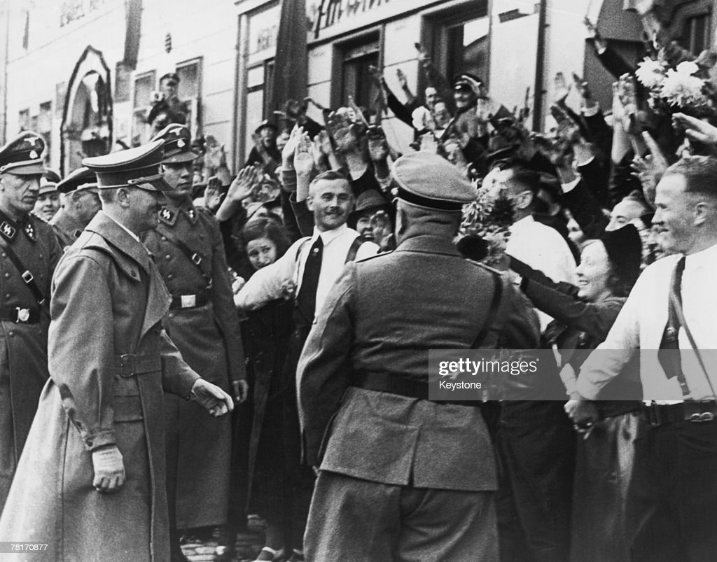 German Nazi leader Adolf Hitler (1889 - 1945) greets crowds in As (Asch) during a visit to Sudetenland, 4th October 1938.