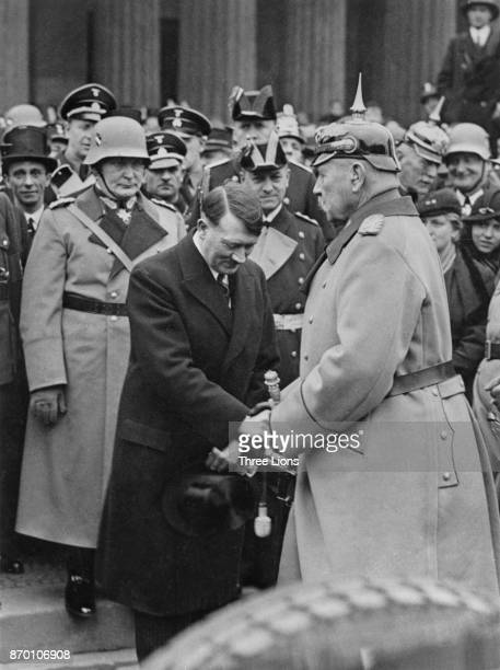 German Nazi Party leader Adolf Hitler meets German President Paul von Hindenburg after Hitler's appointment as Chancellor 1933 Behind Hitler are...