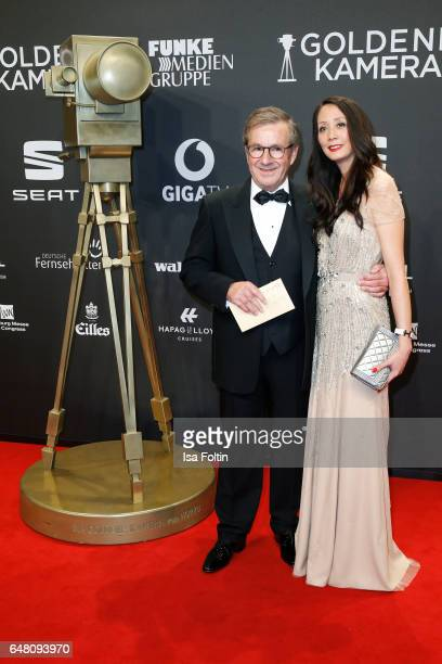 German new anchor Jan Hofer and his girlfriend Phong Lan arrive for the Goldene Kamera on March 4 2017 in Hamburg Germany