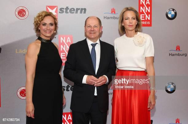 German news anchor Caren Miosga Mayor of Hamburg Olaf Scholz and Chief Executive Officer Gruner Jahr Julia Jaekel during the Henri Nannen Award red...