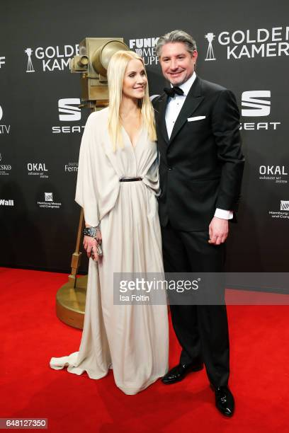 German news anchor Judith Rakers and her husband Andreas Pfaff arrive for the Goldene Kamera on March 4 2017 in Hamburg Germany