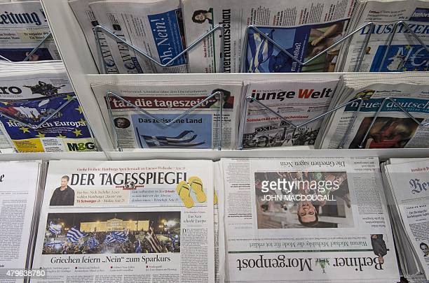 German newspapers fronting pictures of the Greek referendum are seen at a newsstand in Berlin July 6 2015 All eyes were on the European Central Bank...