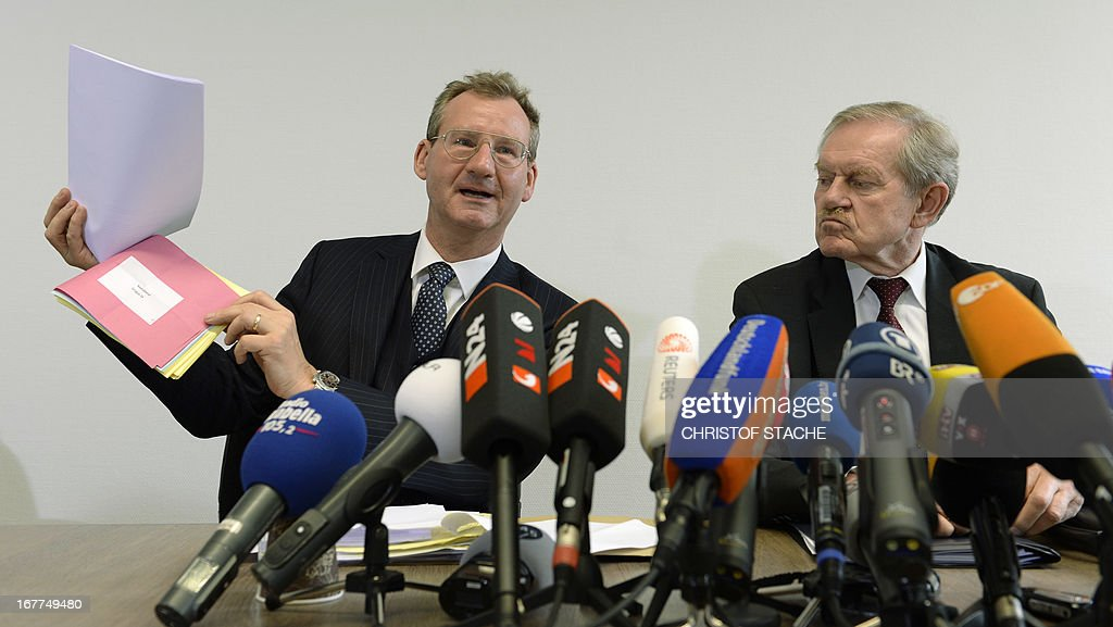 German notary Dieter Mayer (L) and Karl Huber, President of the Higher Regional Court Munich (Oberlandesgerichtes Muenchen), attend a press conference on April 29, 2013 in Munich, southern Germany, after the lottery of the reserved press seats for the trial against the sole survivor of the far-right militants NSU and four other alleged neo-Nazi accomplices, to take place on May 6, 2013.
