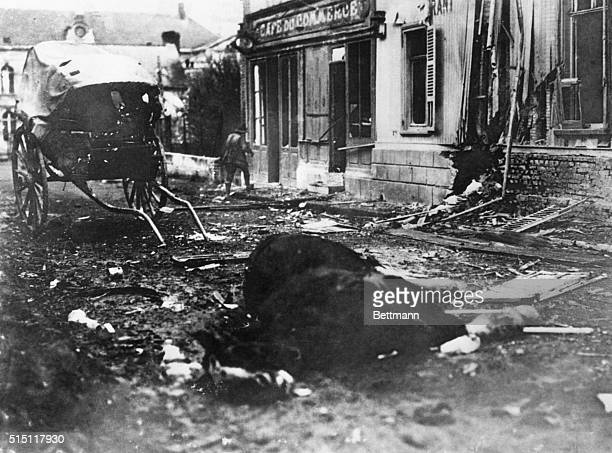 German offensivea French farm cart damaged by shell fire in the street in Villers Bretonneux and its horse killed