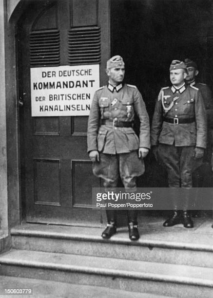 German officers outside the headquarters of the German Commandant of the British Channel Islands Guernsey circa 1943