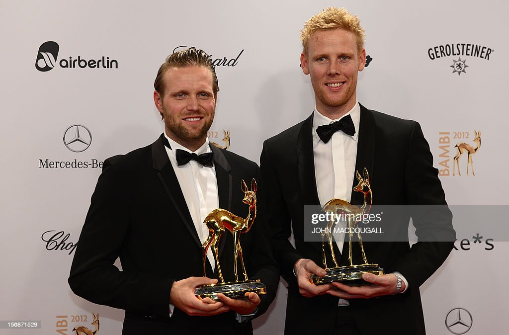 German Olympic Games beachvolleyball gold medal winners Julius Brink (L) and Jonas Reckermann (R) pose with their trophies during the Bambi awardings in Duesseldorf, western Germany, on November 22, 2012. The Bambis are the main German media awards.