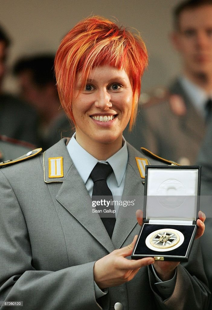 German Olympic medalist and member of the German Federal Armed Forces Kati Wilhelm poses with her Medal of the Minister of Defense at the Ministry of...