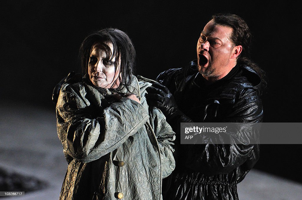 German opera singer Rene Pape (R) in the role of Orest and Swedish soprano Irene Theorin in the role of Elektra perform during a dress rehearsal of the opera 'Elektra' composed by Richard Strauss, on August 4, 2010 in Salzburg. The premiere of the opera will be presented on August 8, 2010 during The Salzburg Festival, the annual high-brow culture fest celebrating this year its 90th anniversary.