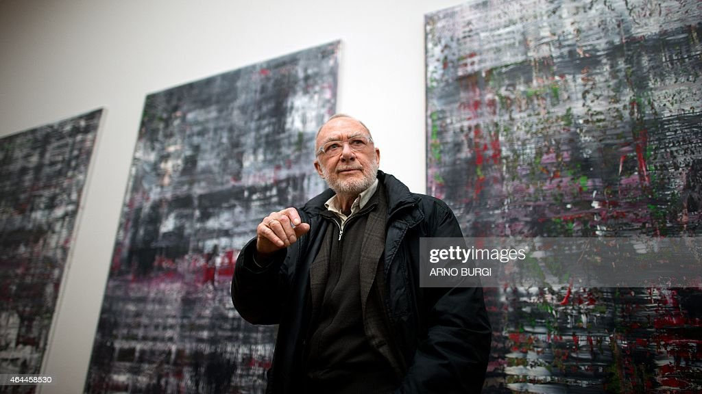 German painter <a gi-track='captionPersonalityLinkClicked' href=/galleries/search?phrase=Gerhard+Richter&family=editorial&specificpeople=661262 ng-click='$event.stopPropagation()'>Gerhard Richter</a> poses in front of his works 'Abstrakte Bilder' (Abstract Pictures, 937-1 to 4, 2014, oil on canvas), on February 25, 2015 at the Albertinum museum in Dresden, eastern Germany. The 83-years-old artist organised a new hanging of his work in the rooms dedicated to him at the museum. AFP PHOTO / DPA / ARNO BURGI +++ GERMANY OUT - RESTRICTED TO EDITORIAL USE, MANDATORY MENTION OF THE ARTIST UPON PUBLICATION, TO ILLUSTRATE THE EVENT AS SPECIFIED IN THE CAPTION
