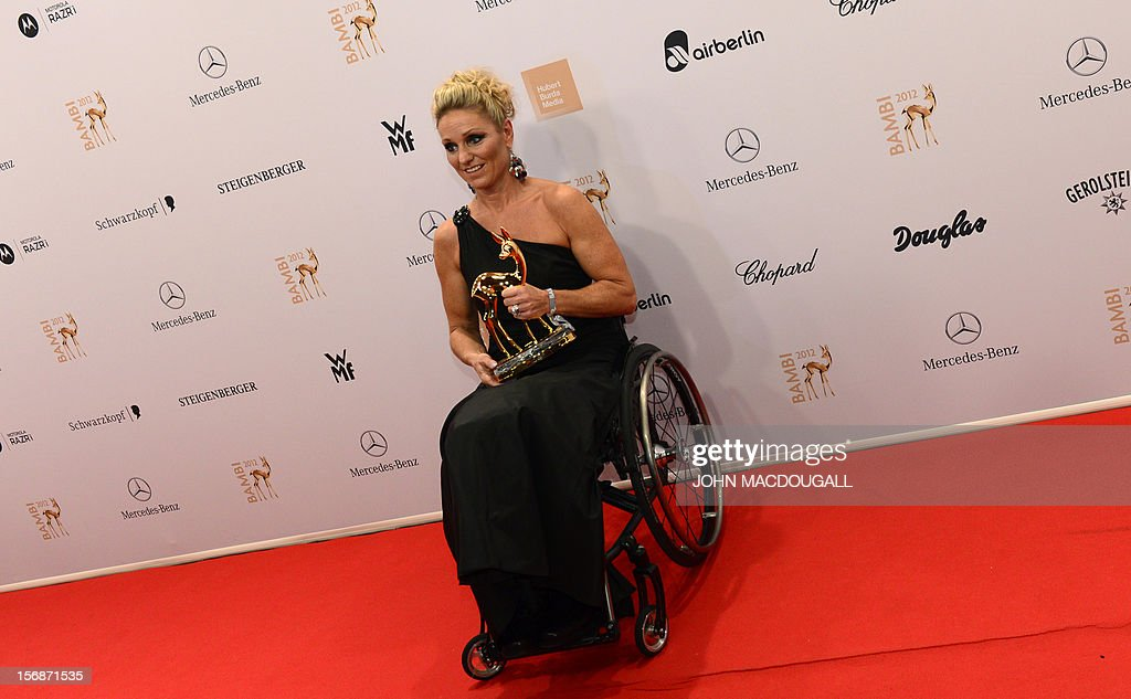 German Paralympics swimming gold medal winner Kirsten Bruhn poses with her trophy during the Bambi awardings in Duesseldorf, western Germany, on November 22, 2012. The Bambis are the main German media awards.