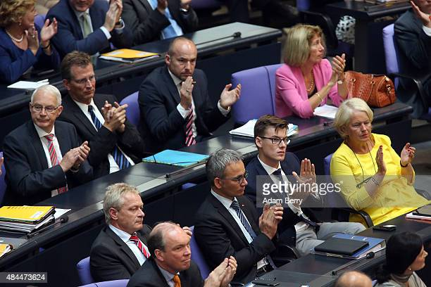 German parliamentarians applaud during a meeting of the Bundestag about a third bailout package for economicallytroubled Eurozone member Greece...