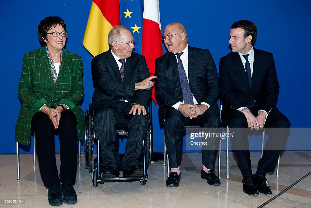German parliamentary state secretary at the Ministry of Economic Affairs, <a gi-track='captionPersonalityLinkClicked' href=/galleries/search?phrase=Brigitte+Zypries&family=editorial&specificpeople=601207 ng-click='$event.stopPropagation()'>Brigitte Zypries</a>, German Finance Minister Wolfgang Schauble, French Finance Minister <a gi-track='captionPersonalityLinkClicked' href=/galleries/search?phrase=Michel+Sapin&family=editorial&specificpeople=668944 ng-click='$event.stopPropagation()'>Michel Sapin</a> and <a gi-track='captionPersonalityLinkClicked' href=/galleries/search?phrase=Emmanuel+Macron&family=editorial&specificpeople=9899223 ng-click='$event.stopPropagation()'>Emmanuel Macron</a>, French Minister of Economy pose during a photo family at the minister of finances on February 9, 2016 in Paris, France. <a gi-track='captionPersonalityLinkClicked' href=/galleries/search?phrase=Michel+Sapin&family=editorial&specificpeople=668944 ng-click='$event.stopPropagation()'>Michel Sapin</a> meets Wolfgang Schauble for a Franco-German Economic Council.