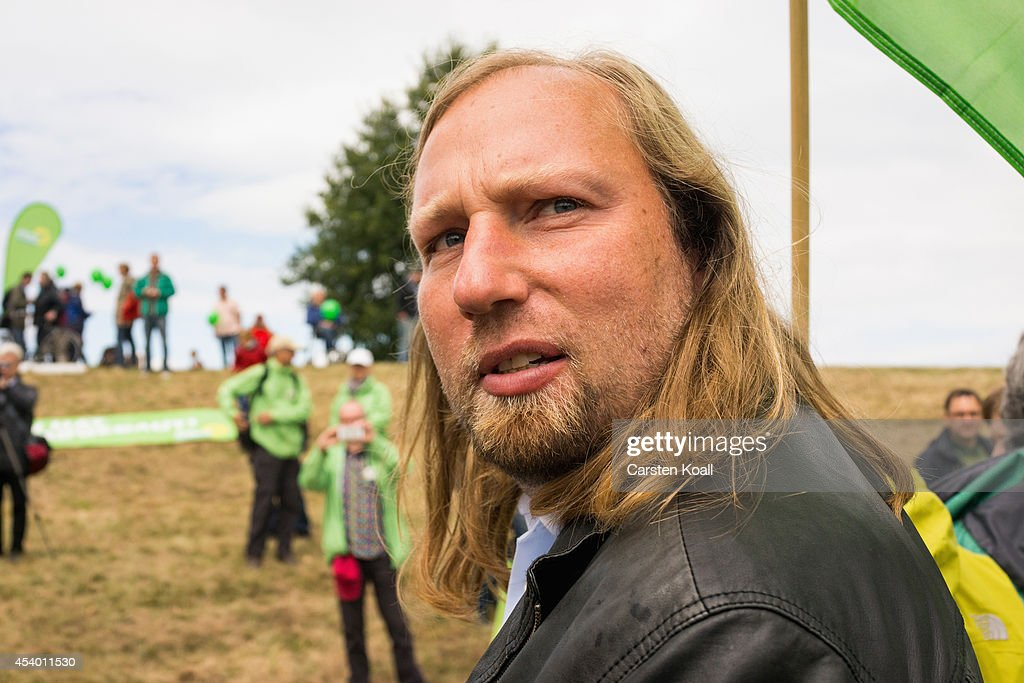 German partyleader <a gi-track='captionPersonalityLinkClicked' href=/galleries/search?phrase=Anton+Hofreiter&family=editorial&specificpeople=11451109 ng-click='$event.stopPropagation()'>Anton Hofreiter</a>, German Greens Party (Buendnis 90/Die Gruenen) Bundestag faction co-leader attends a rallye of activists protesting against the expansion of nearby open-pit coal mines form a human chain from Germany into Poland on August 23, 2014 near Gross Gastrose, Germany. Thousands of demonstrators participated in the event to protest against plans by Swedish energy conglomerate Vattenfall and Polish energy supplier PGE to expand open-pit lignite coal mines in the region that would mean razing several villages, including Atterwasch and Kerkwitz in Germany and Grabice in Poland. On the German side the nearby Jaenschwalde power plant is the single biggest emitter of CO2 in Europe.