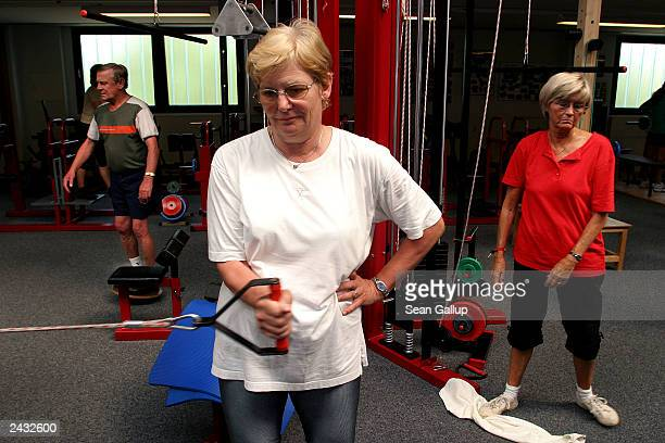 German pensioners including 63yearold Barbara Berdin exercise at a gym August 27 2003 in Fuerstenfeldbruck Germany German political parties are...