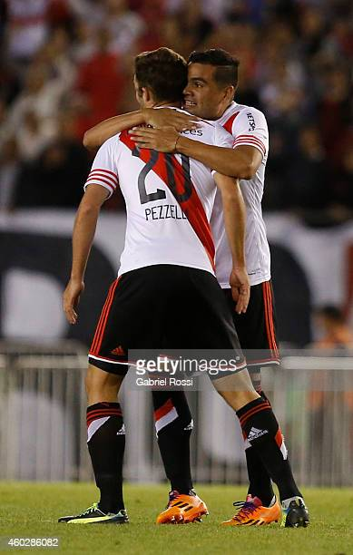 German Pezzella and Gabriel Mercado of River Plate celebrate after scoring the second goal of his team during a second leg final match between River...
