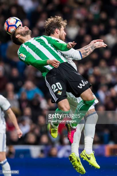 German Pezzella of Real Betis battles for the ball with Sergio Ramos of Real Madrid during their La Liga match between Real Madrid and Real Betis at...