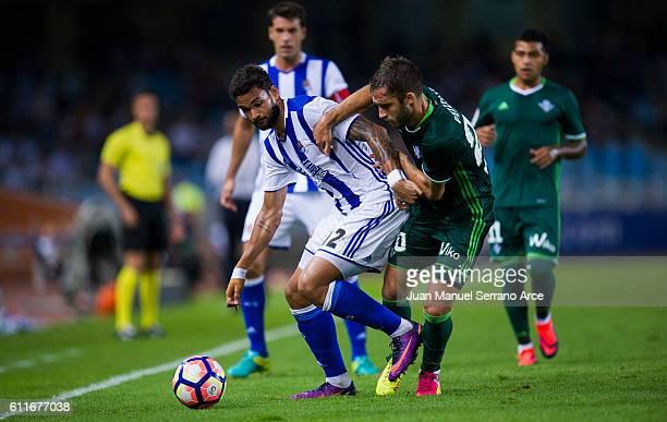 German Pezzella of Real Betis duels for the ball with Willian Jose Da Silva of Real Sociedad during the La Liga match between Real Sociedad de Futbol...