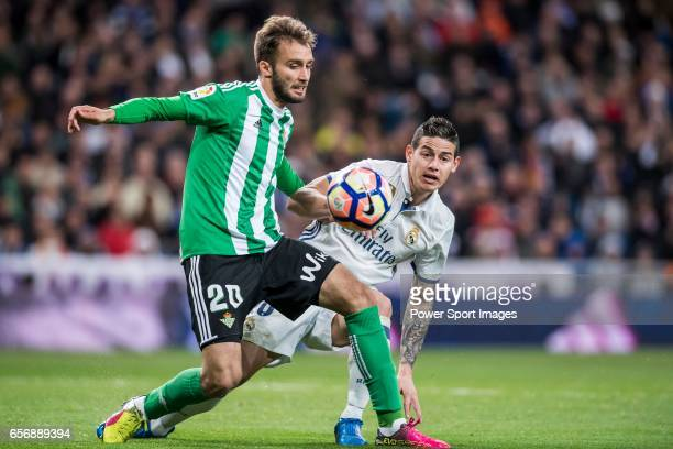 German Pezzella of Real Betis fights for the ball with James Rodriguez of Real Madrid during their La Liga match between Real Madrid and Real Betis...