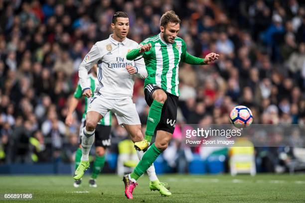 German Pezzella of Real Betis is followed by Cristiano Ronaldo of Real Madrid during their La Liga match between Real Madrid and Real Betis at the...