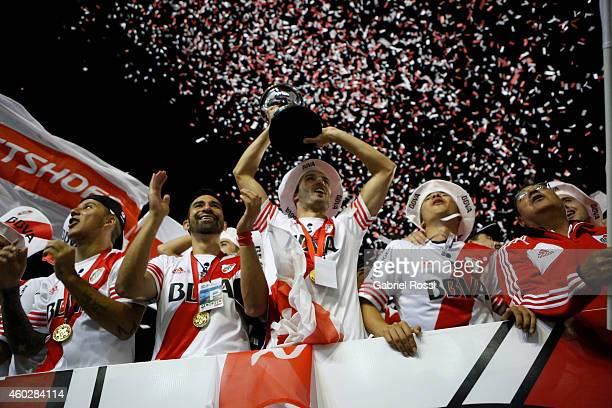German Pezzella of River Plate celebrates with the trophy after a second leg final match between River Plate and Atletico Nacional as part of Copa...